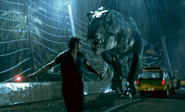 Actor Jeff Goldblum runs for his life from the T. rex in Jurassic Park. Photo- Geeksonfilm.