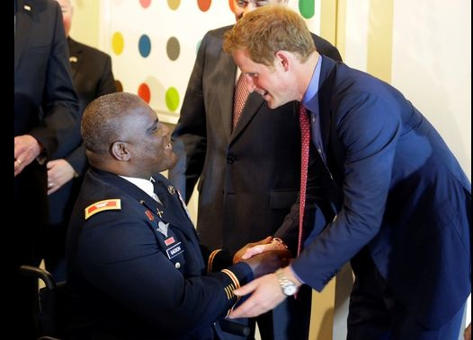 Prince Harry meets U.S. Army Col. Gregory Gadson at a dinner at the British Embassy.(Photo- Alex Brandon AFP:Getty Images)