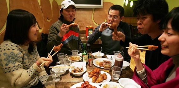 Koreans At Unidentified Flying Chickens in Jackson Heights. Photo: Hiroko Masuike for The New York Times.
