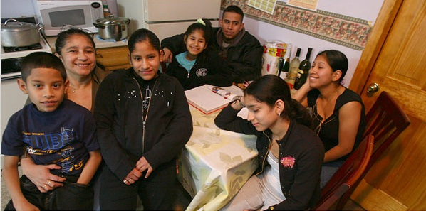 Sandra Vallejo of Ecuador at home in Queens with six of her seven children. Andrea Mohin:The New York Times.
