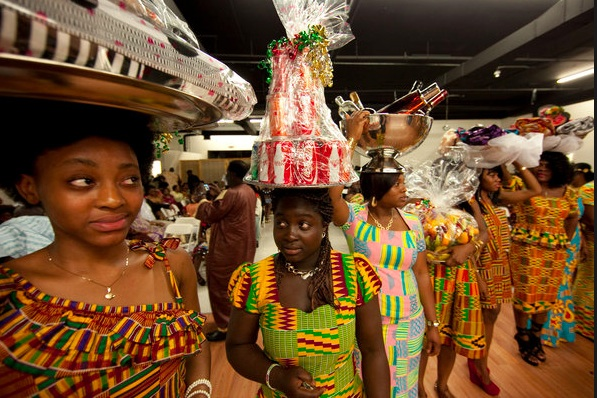 Women lined up to present gifts to Mr. Acheampong-Tieku, the Ashanti chief of New York during the ceremony in the Bronx last month. Photo- Dave Sanders for The New York Times.