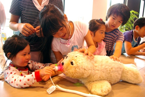 Children love Paro. Photo Science Day