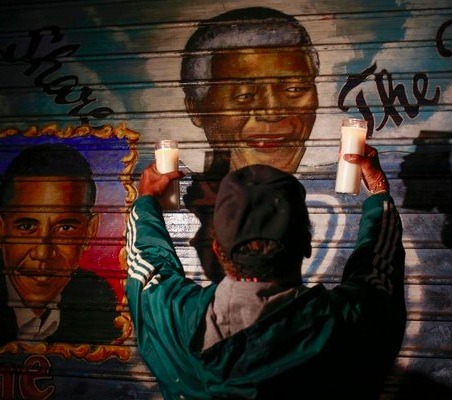 A man offered candles at a mural of Mr. Mandela in New York City. Shannon Stapleton:Reuters.