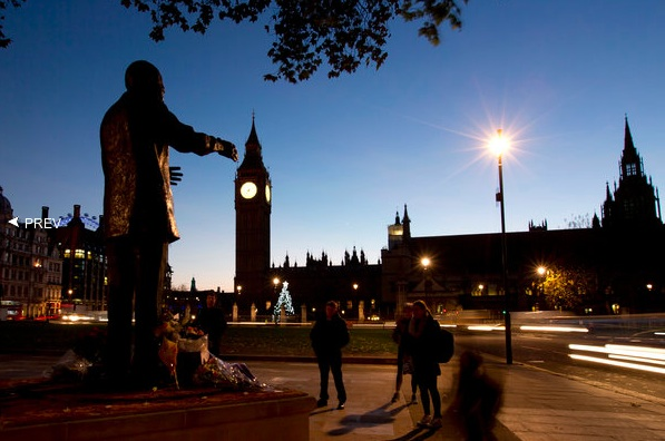 Early commuters stood in silence next to a statue of Mr. Mandela in London's Parliament Square. Alastair Grant:AP.