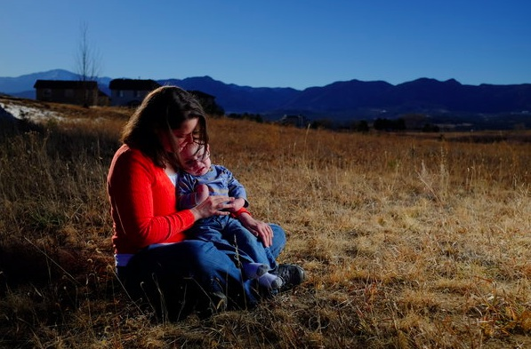 Marisa Kiser was drawn to Colorado in the hopes of relieving seizures suffered by her 19-month-old son, Ezra. NYT.