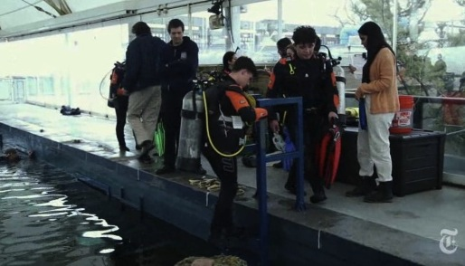 Students prepare to dive. Photo- Ruth Fremson:The New York Times.