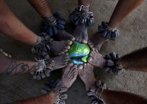 The Tatuyo tribe in the Amazonian village of Tupe play soccer with bare feet as the best players in the world play just a few miles away. Credit David Lazar