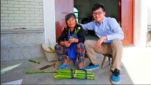 Gu Hangyu, sits with his grandmother Wang Yufang, on Chongming Island near Shanghai. She speaks the Chongming dialect, but not standard Chinese. Credit- Ruth Morris