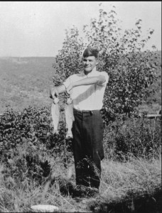 A young Hemingway poses with fish that he caught in Wallon Lake in Michigan 1916. Photo credit metrotimes.com