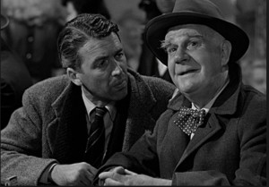 Actors James Stewart (George Bailey) and Henry Travers (Clarence Odbody-guardian angel) in 1944 film- It's A Wonderful Life.