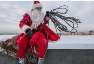 Father Frost (equivalent of Santa) rests on a high-rise building in Kemerovo Russia
