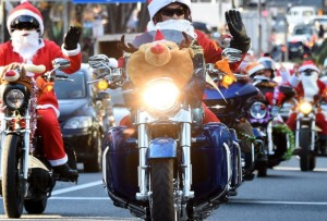 In Tokyo Japan Santas from the Harley Santa Club deliver toys in a campaign against child abuse. CNN