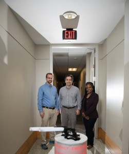 Georgia Tech researchers shown with their Rescue Robot.(L-R) Research Engineer Paul Robinette, Research Engineer Alan Wagner and Computer Engineering Professor Ayanna Howard. (Credit- Rob Felt, Georgia Tech)