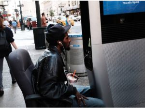 a man gets comfy using one of the new wi-fi kiosks as a living room. NYPost