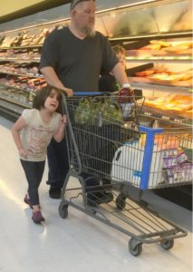 a-man-wrapped-his-daughters-hair-around-the-handle-of-a-shopping-cart-and-pulled-her-along-in-a-walmart-photo-credit-erika-burch